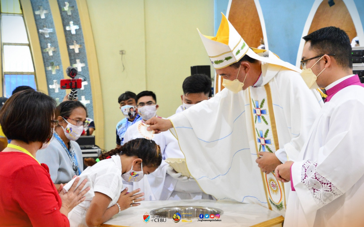 100 newly baptized in commemorating first Baptism in Philippines